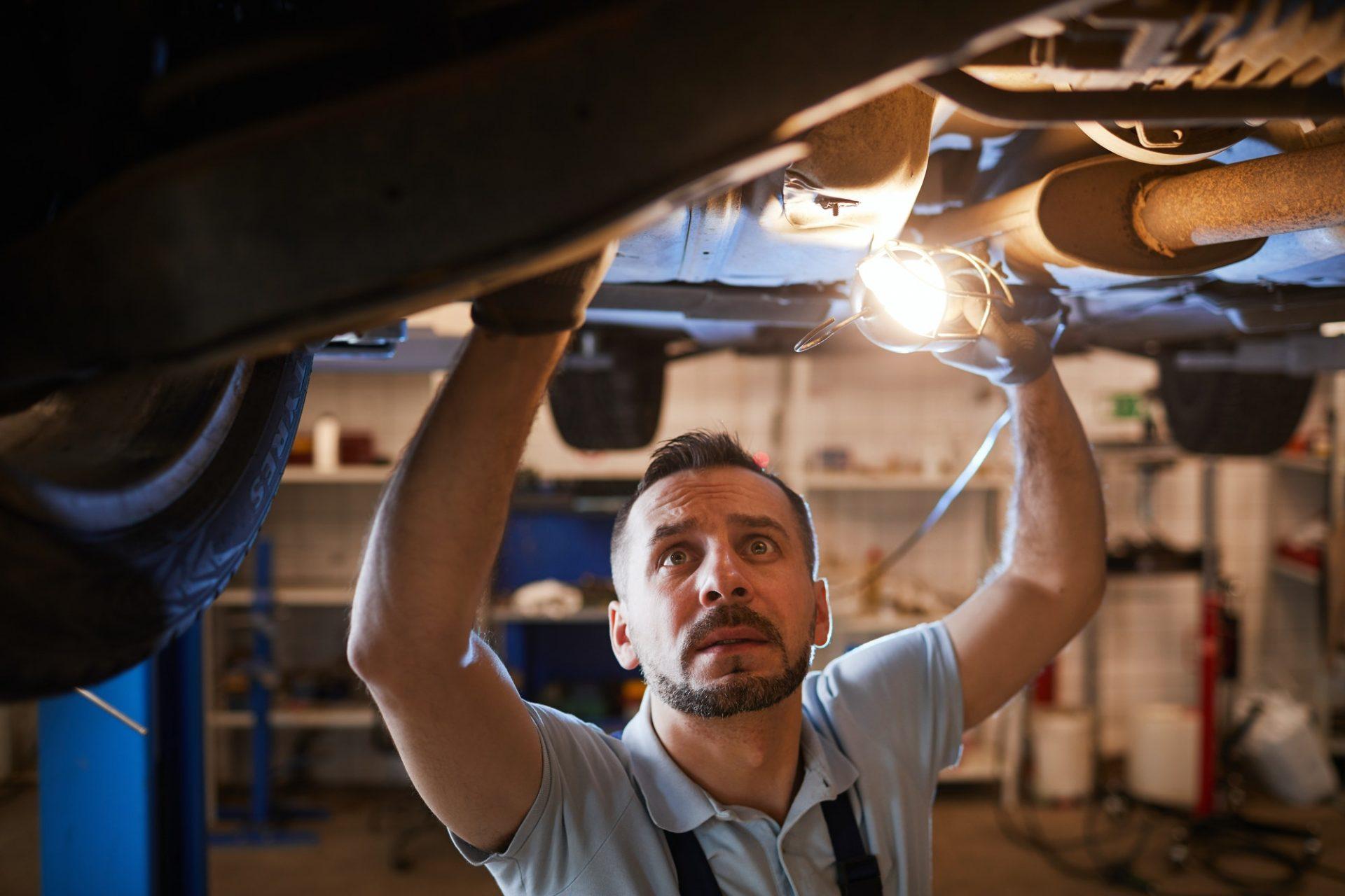 Car Mechanic Working in Garage