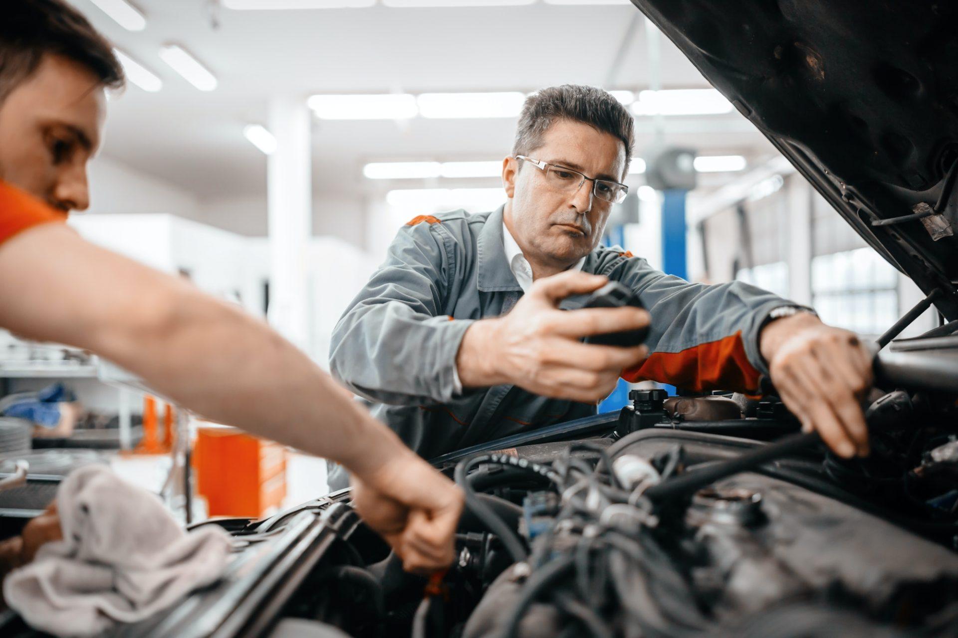 Car mechanics working and maintaining car