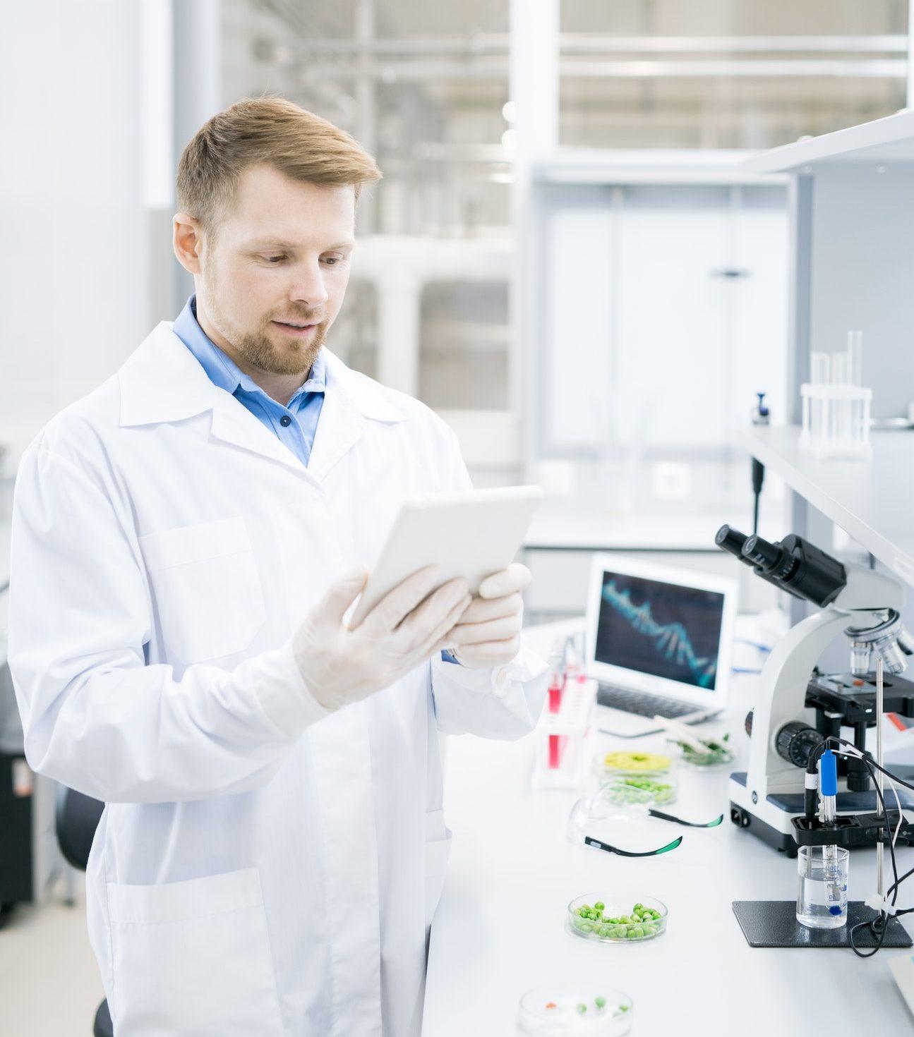 Modern Scientist Using Tablet in Laboratory