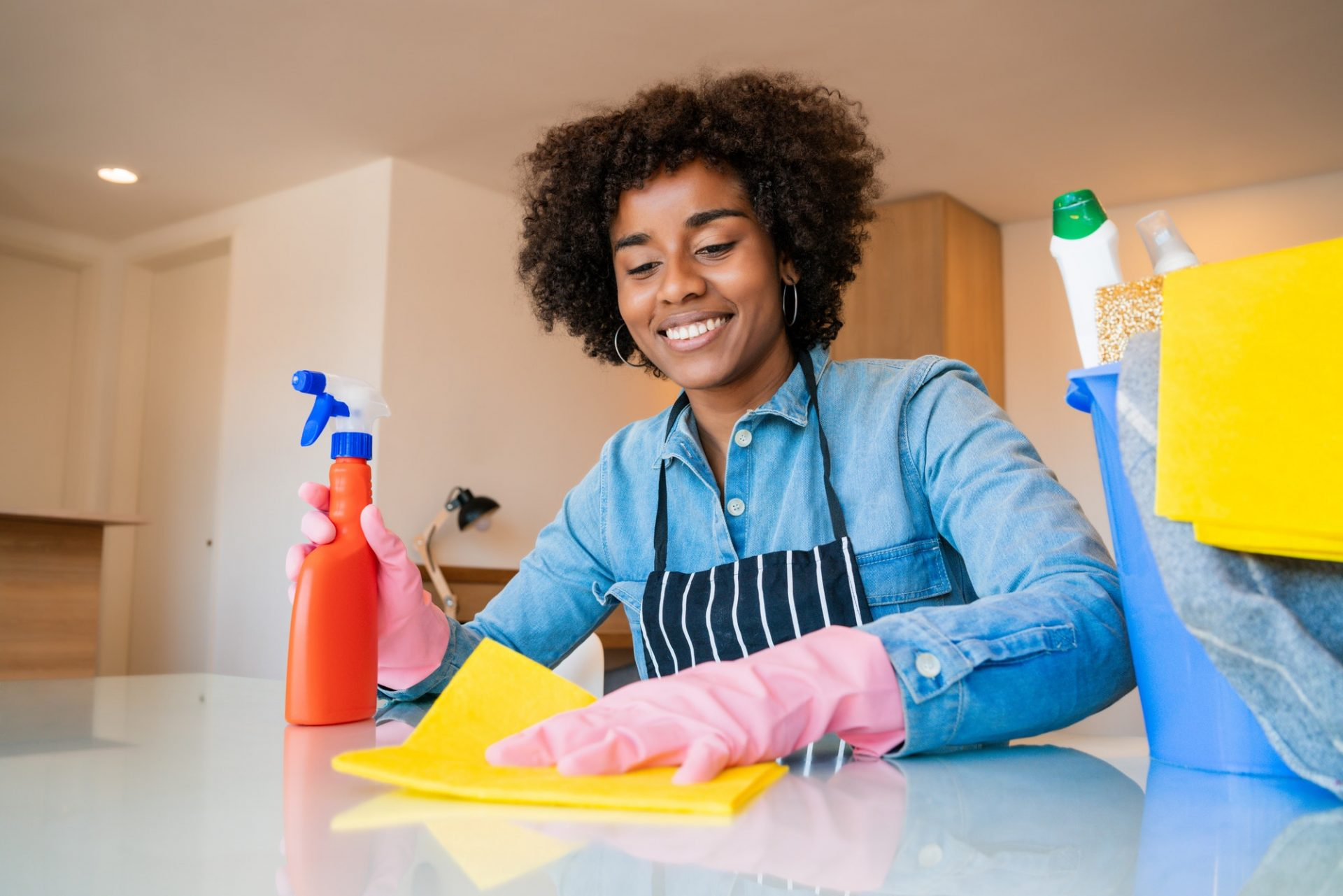 Afro woman cleaning new home.