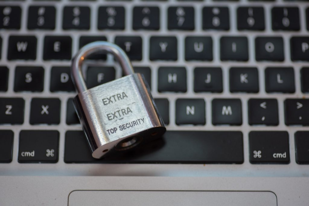 Lock pad isolated against keyboard of laptop depicting internet security