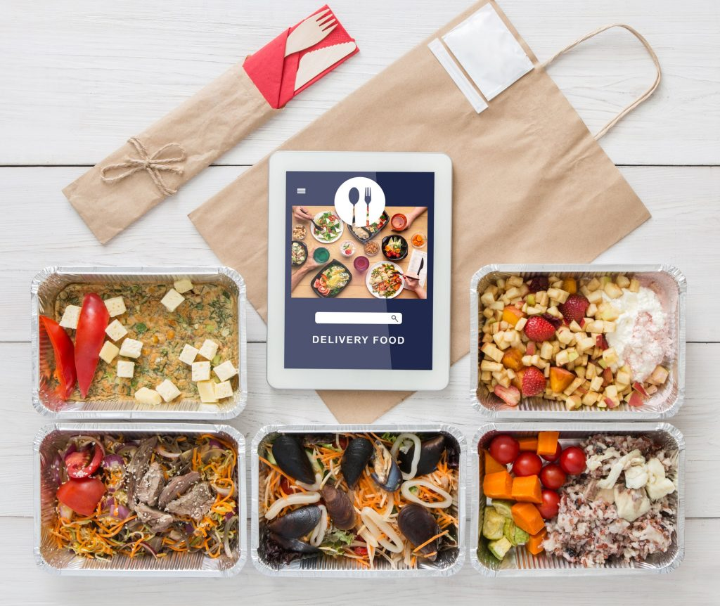 Vegetarian set in ecological packaging. Food with tofu, mussels and vegetables in containers