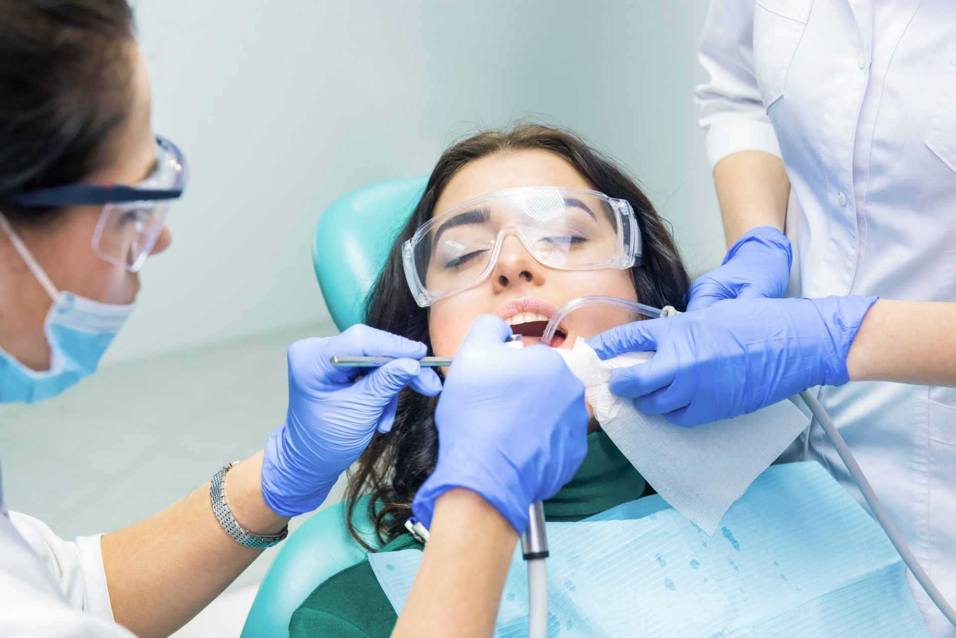 Dentists are working with patient