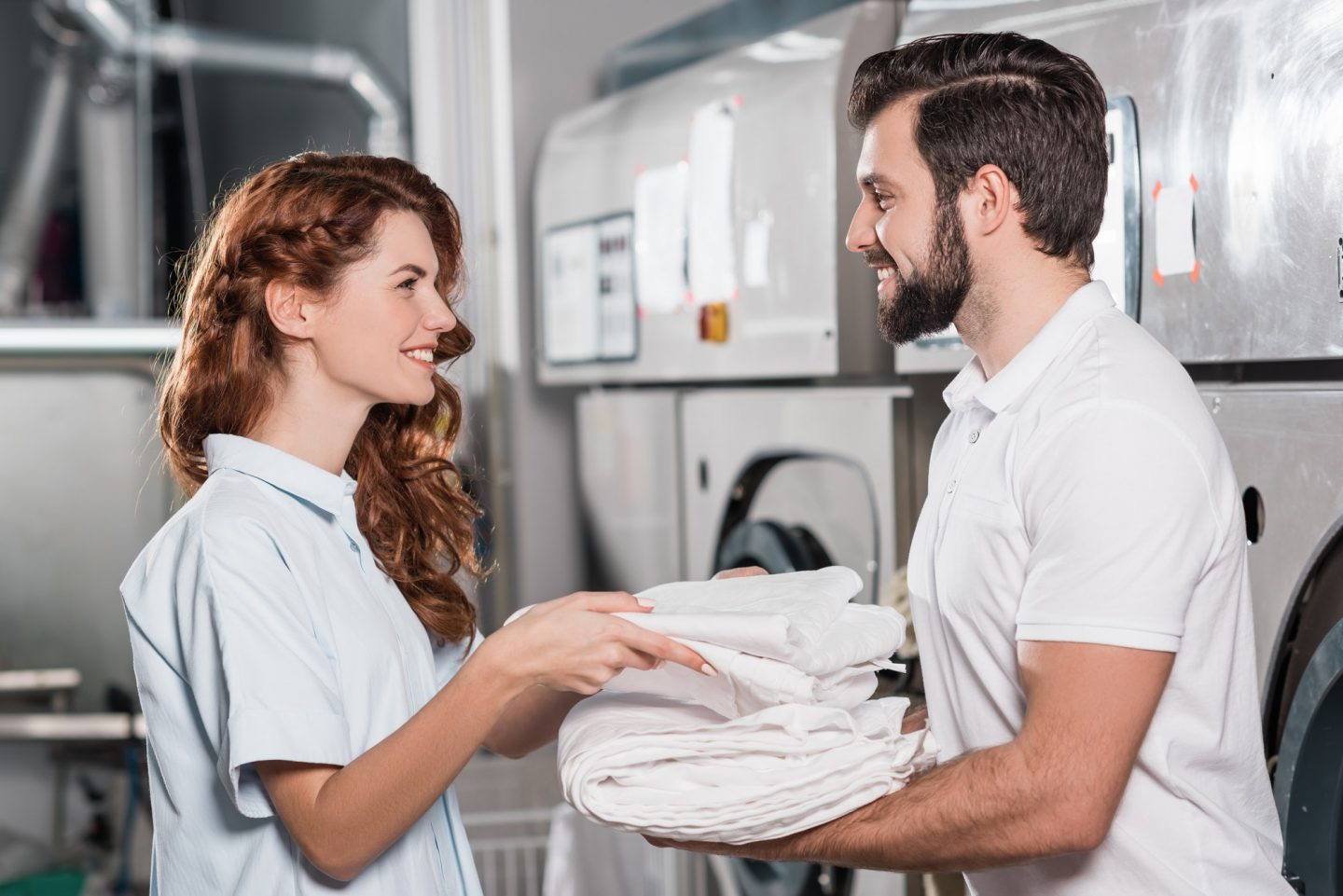 dry cleaning managers working together at laundry