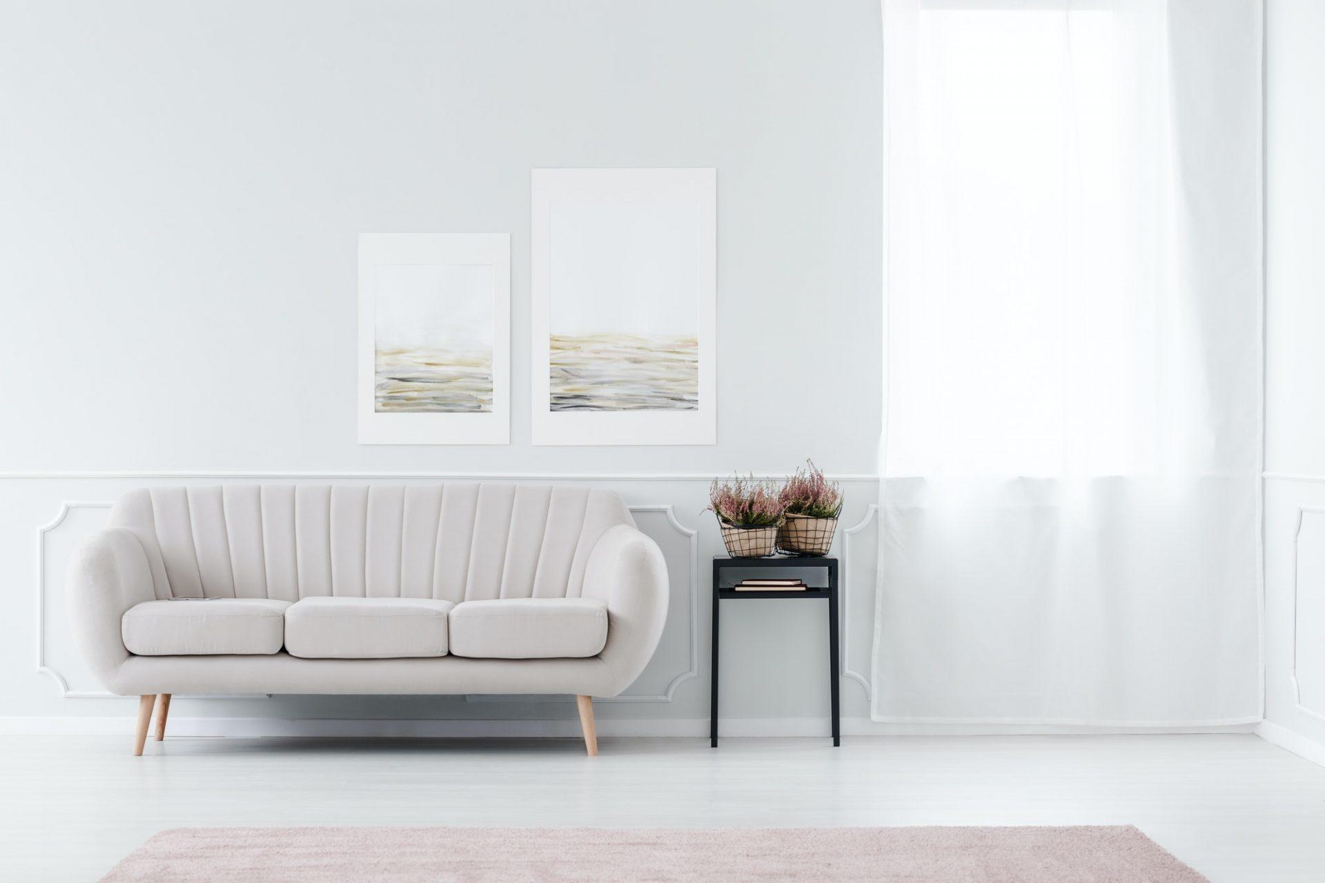 Beige sofa near window
