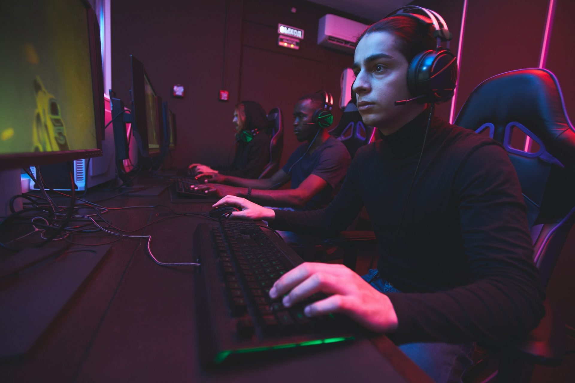 E-sports gamers playing online game via network