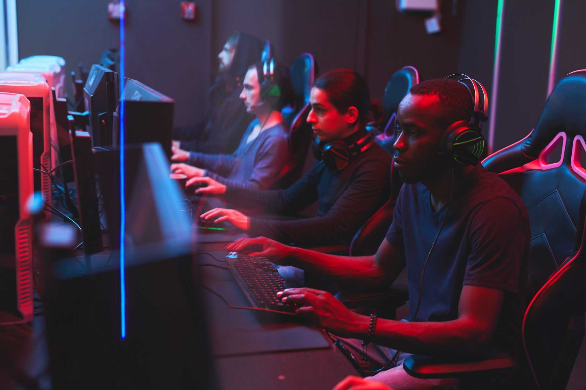 Online gamers playing strategy games in computer club