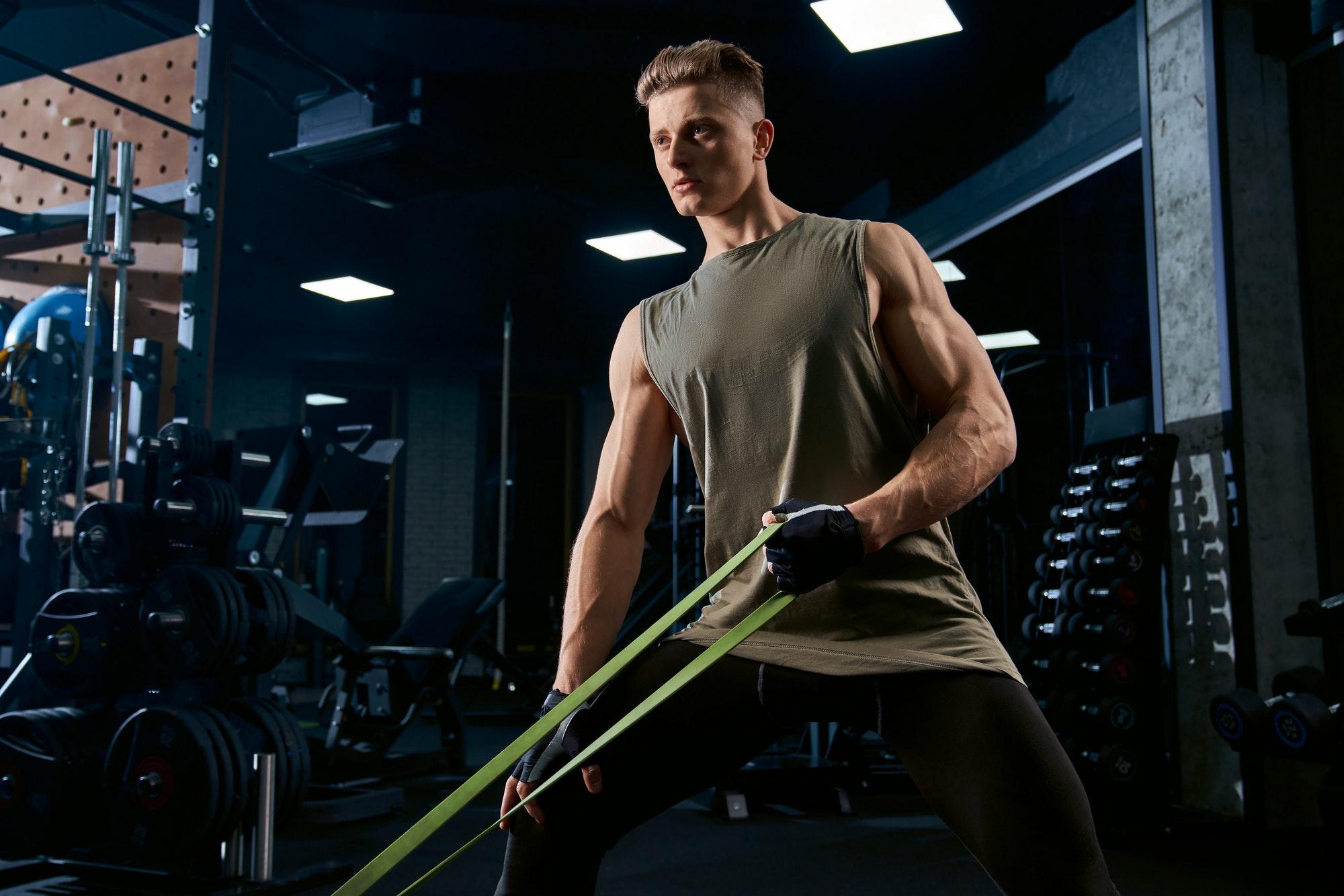 Bodybuilder training back on exercise machine