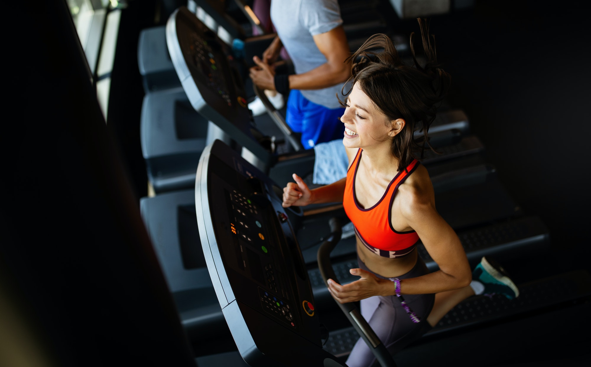 Fit group of people exercising on a treadmill in gym