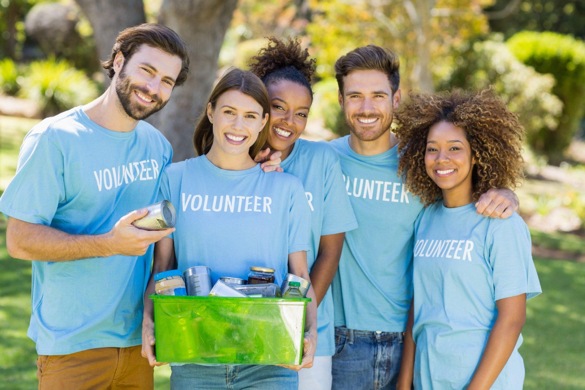 Portrait of volunteer group holding box