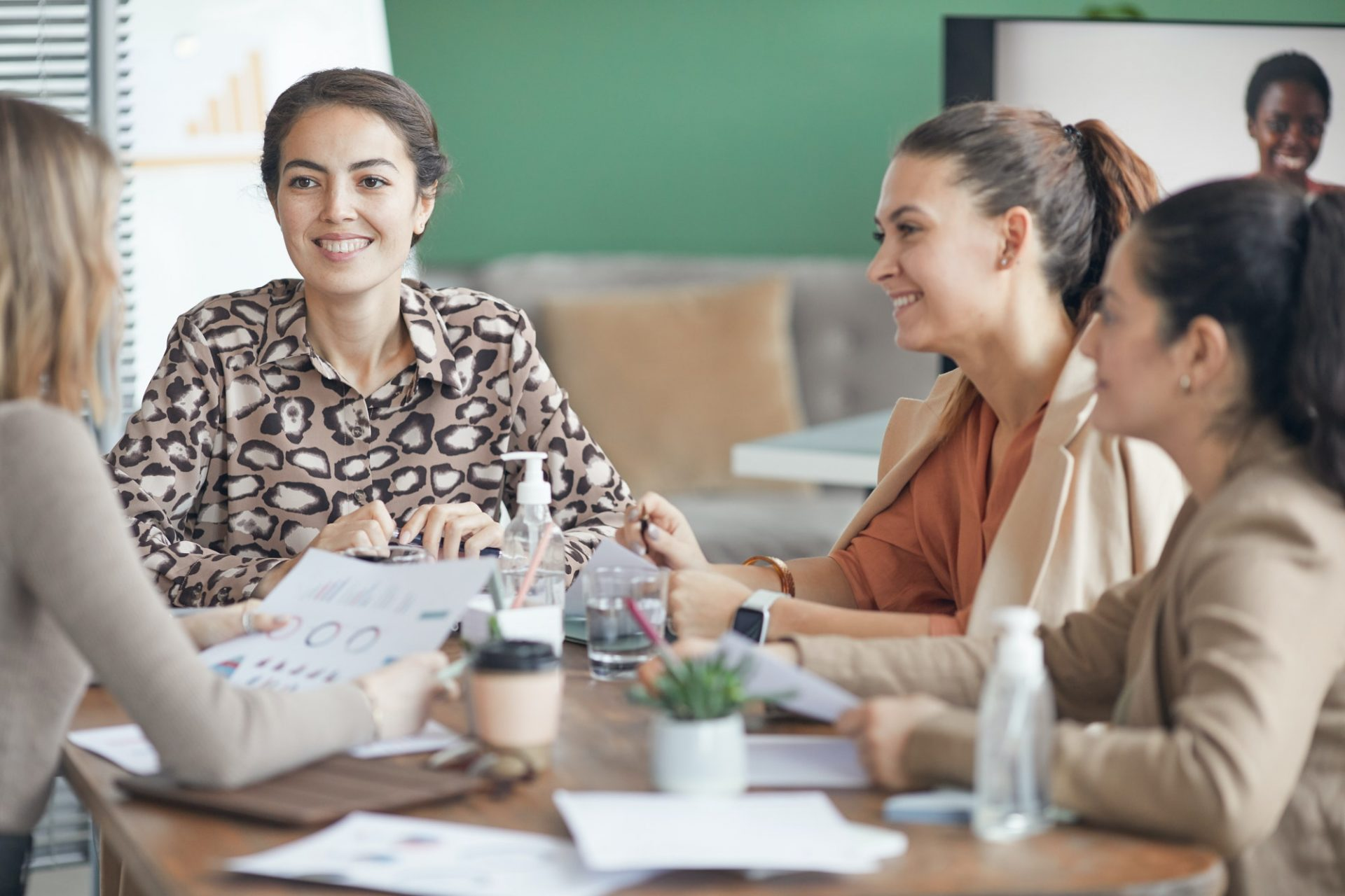 Group of Smiling Women in Business Meeting