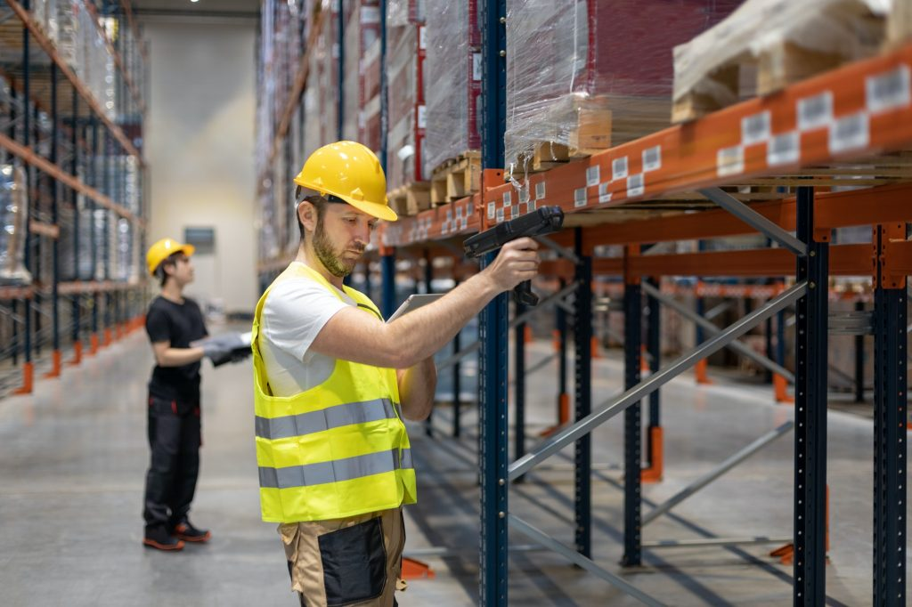 Workers in warehouse scanning packages