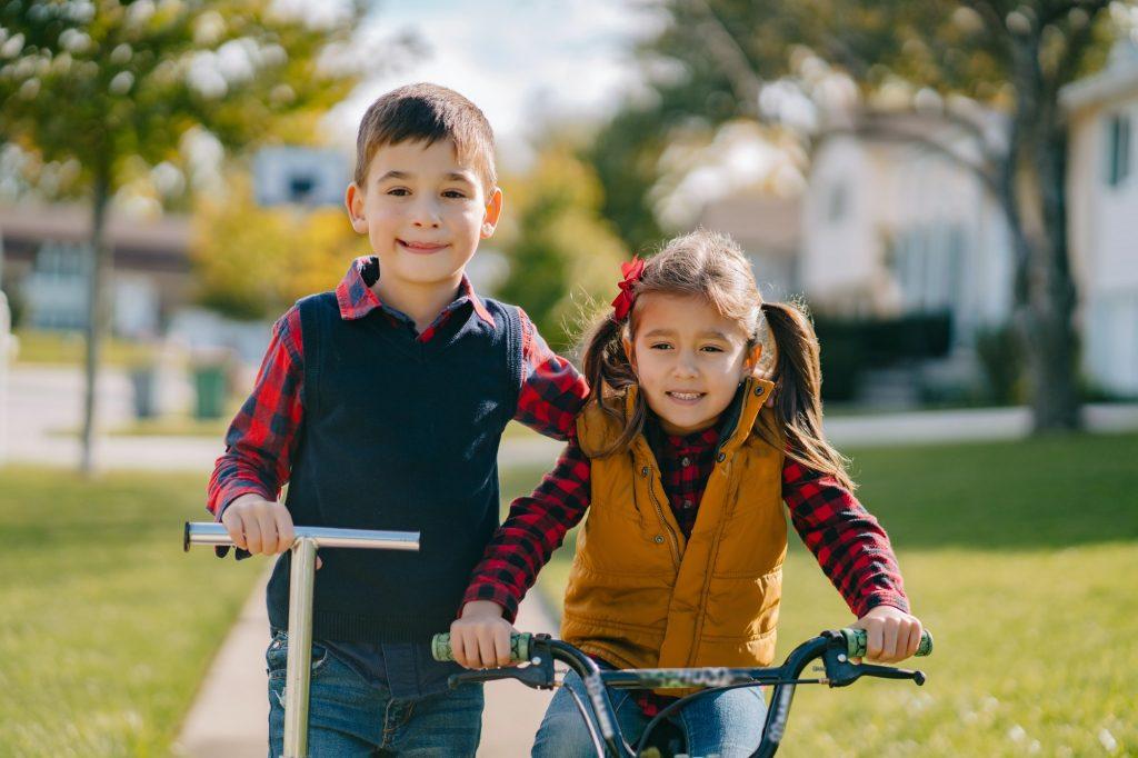 Little kids in a autumn park