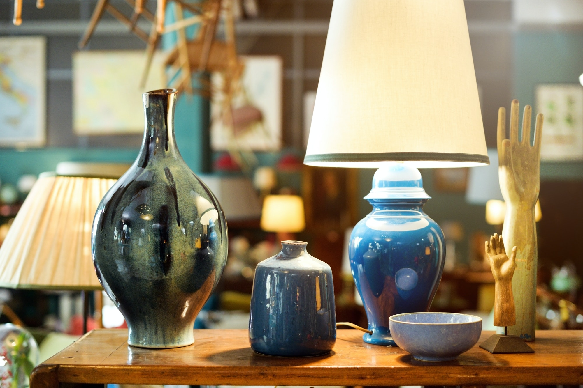 Display of handmade colorful glazed pottery or ceramics in a store