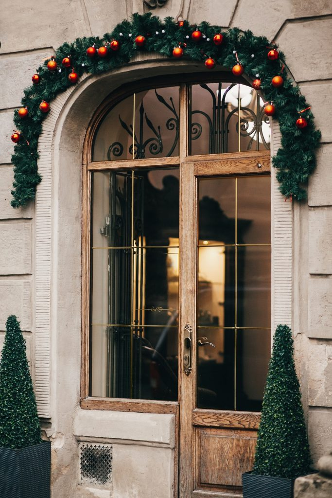 Stylish christmas decorations, garland lights and fir branches