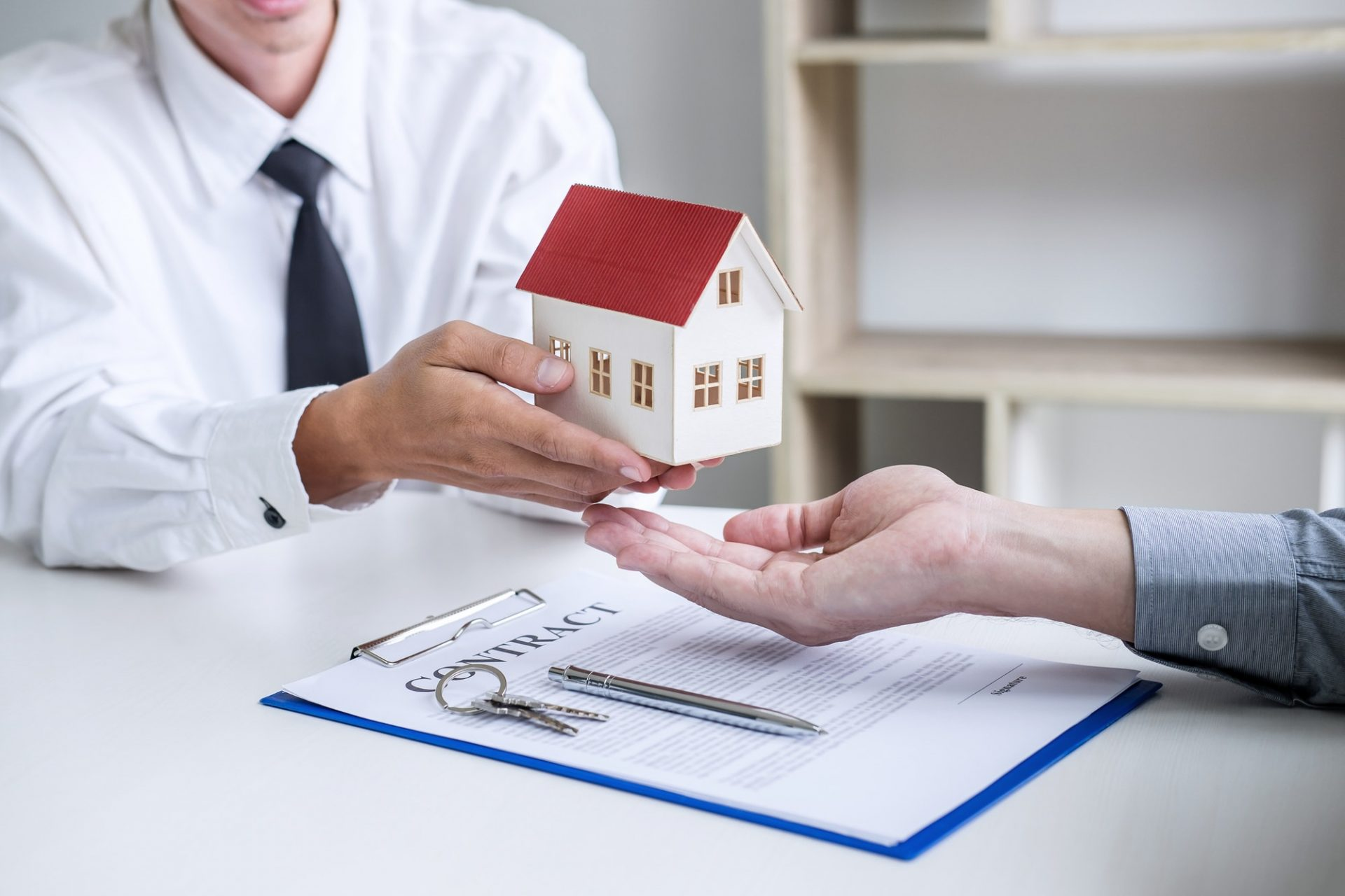 Real estate broker agent presenting and consult to customer to decision making sign insurance form