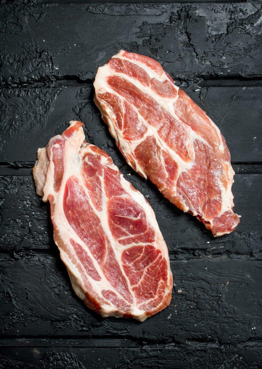 Raw pork steaks.