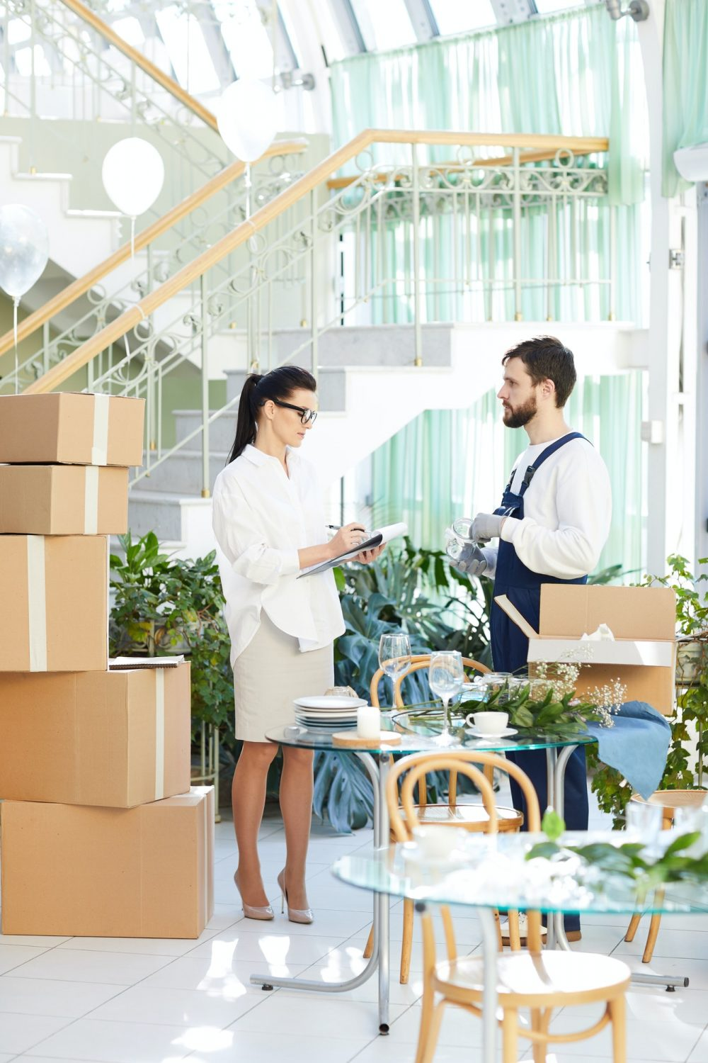 Business lady asking mover about delivery order