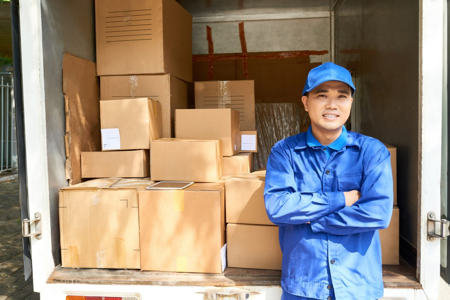 Courier standing at truck loaded truck