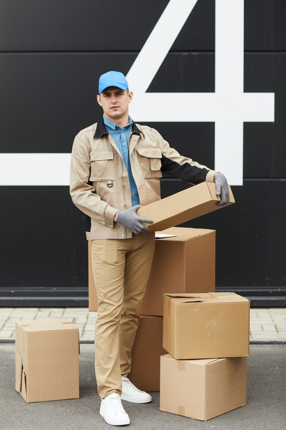 Courier working with parcels in warehouse