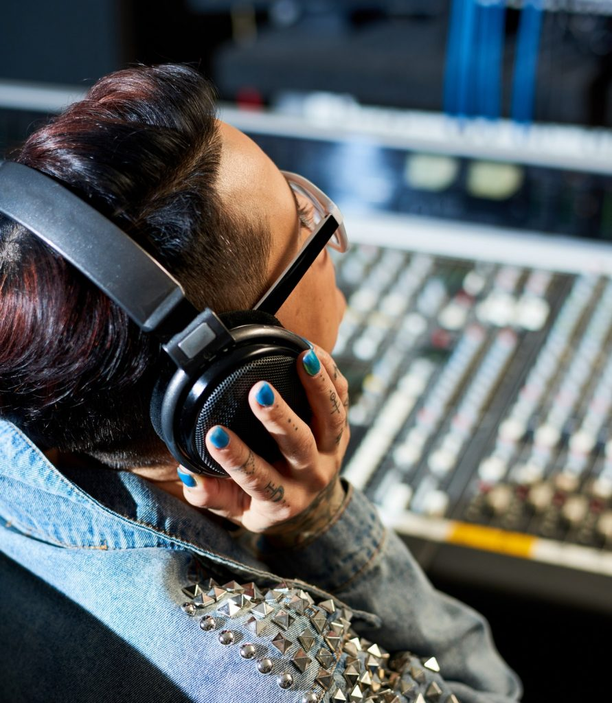 Producer listening to audio track in studio