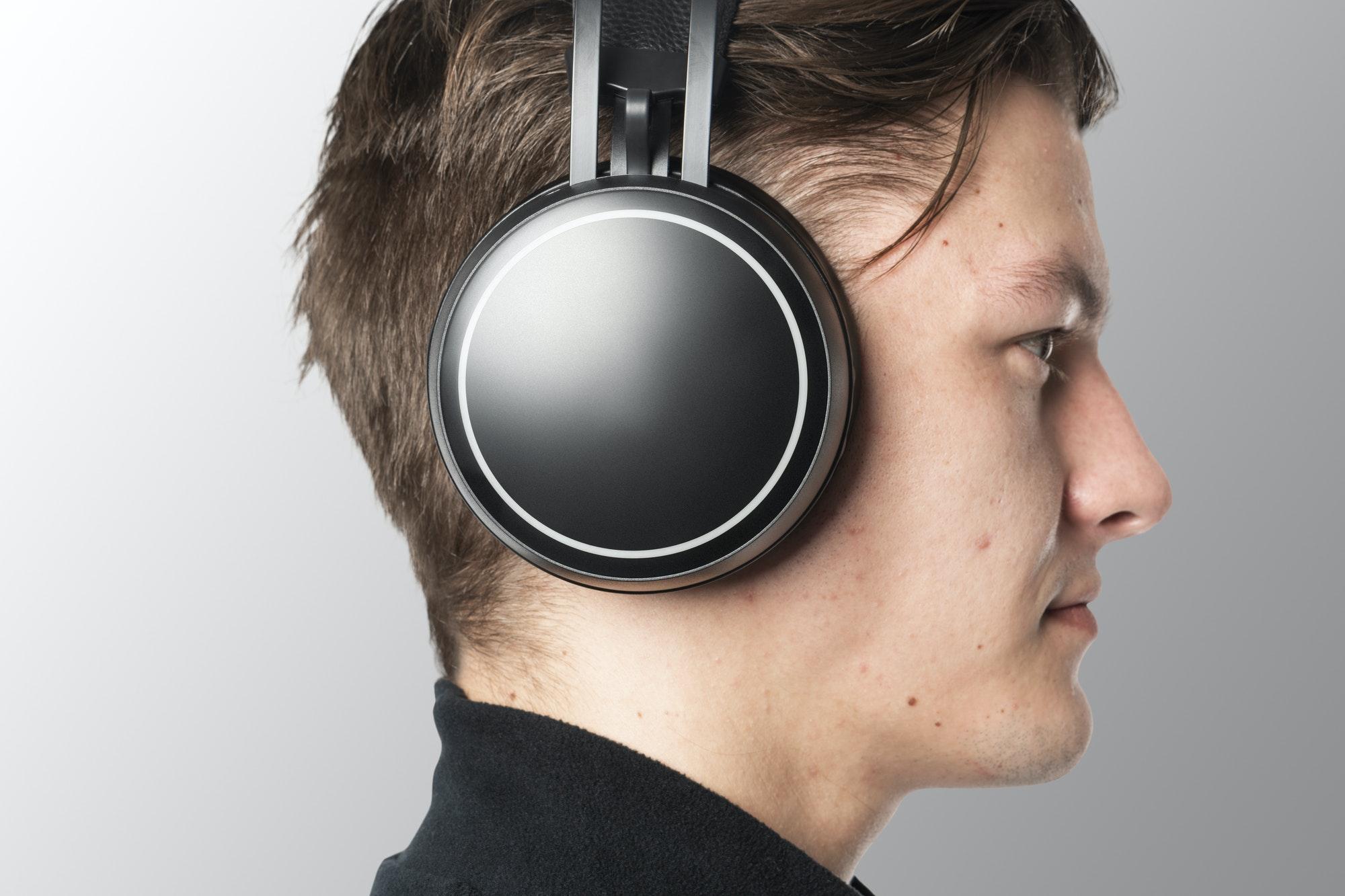 Man listening music with wireless headphones