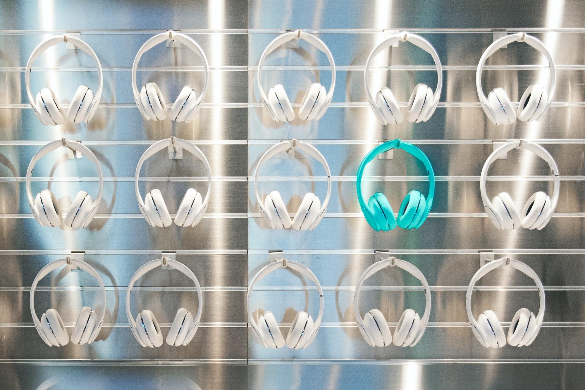 Wall of headphones