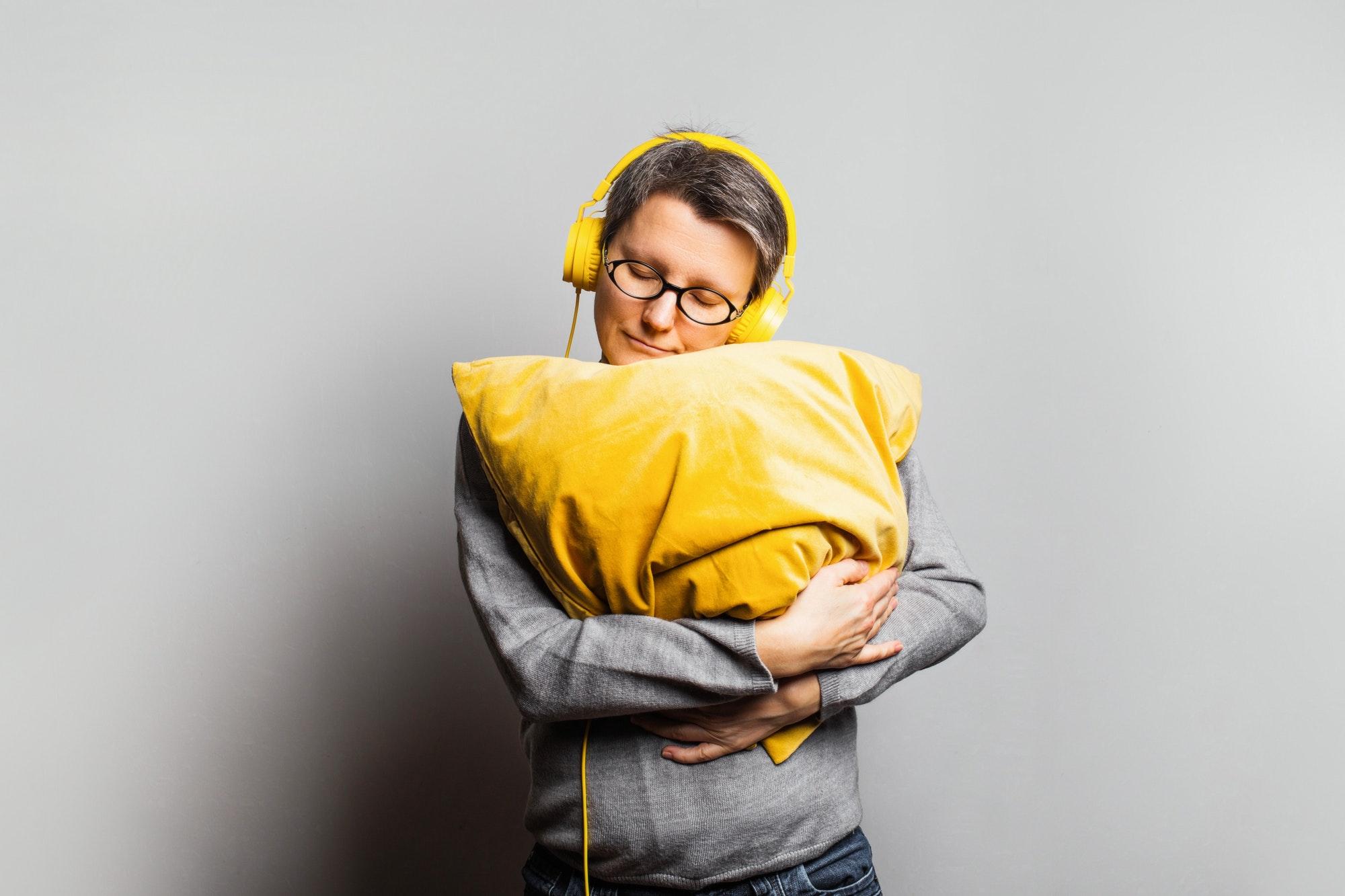 Woman in yellow headphones