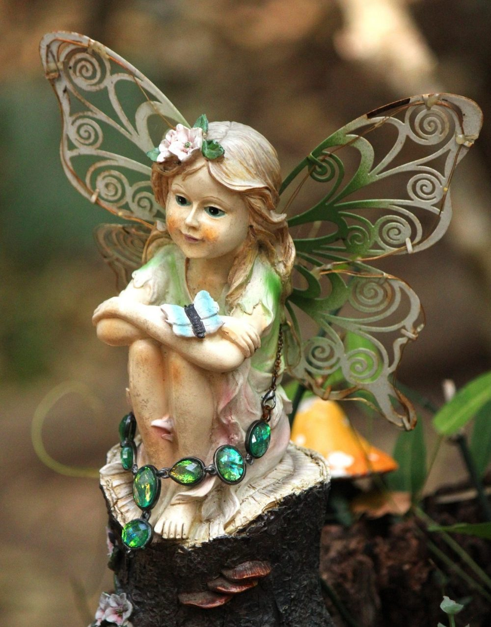 Statue of a little fairy in the back of the garden