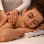 Woman getting healing body massage session at newest spa