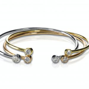 Set of three colored gold and diamond bracelets stacked