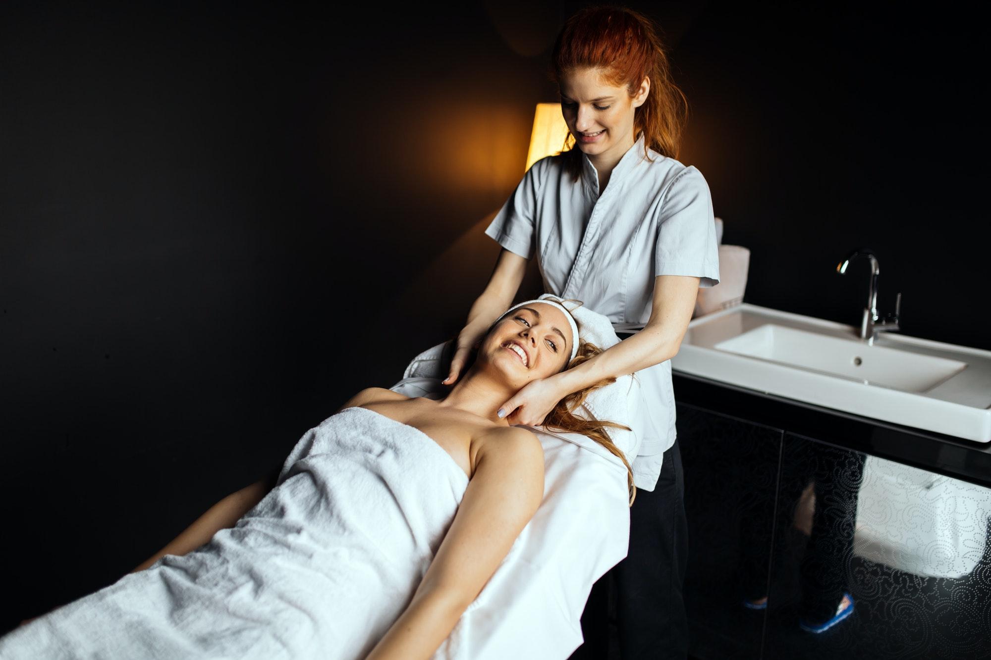 Masseur giving treatment