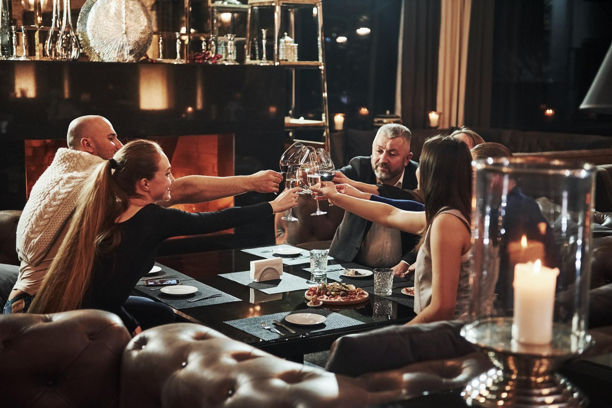 Family friends having nice time in beautiful luxury modern restaurant