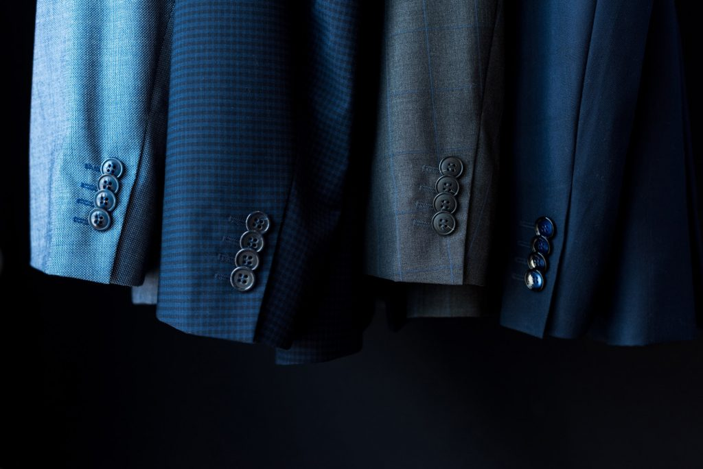 close-up view of fashionable suit jackets in boutique