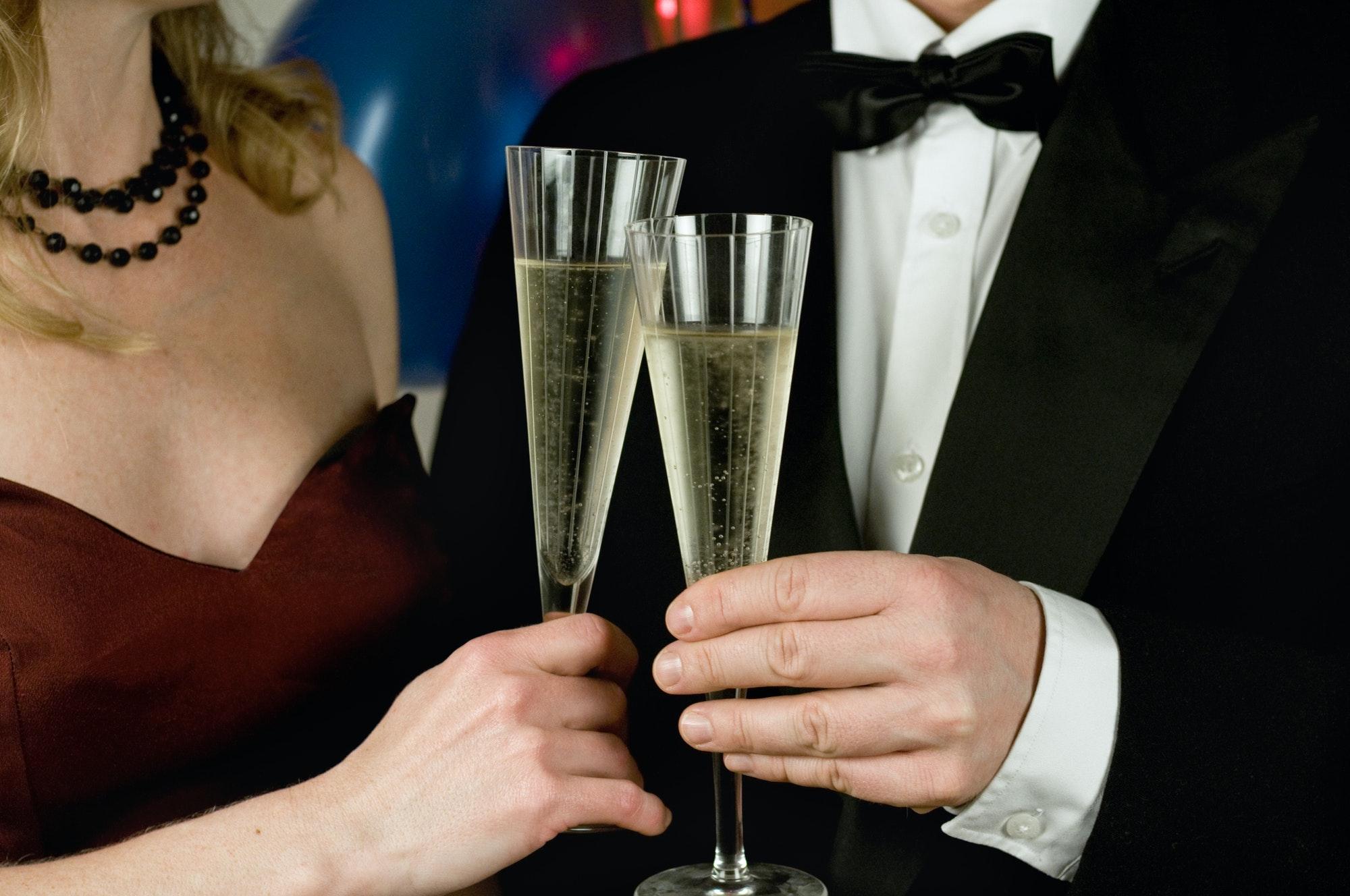 Elegant couple holding champagne glasses