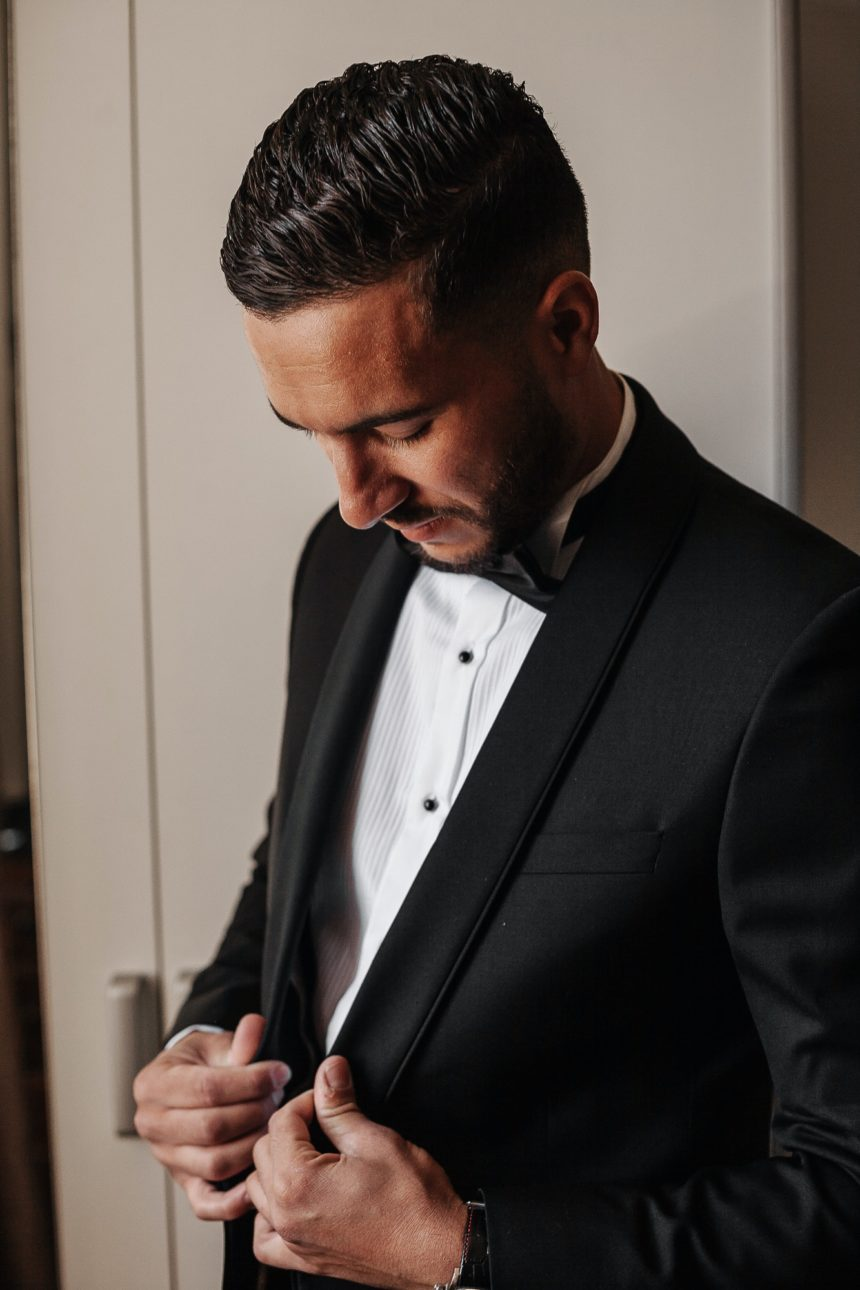 Man wearing a black blazer and a bow tie