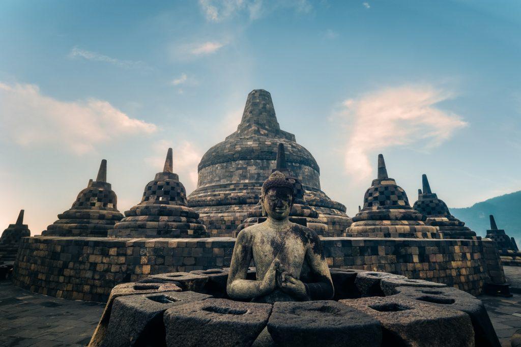 Statue of meditating Buddha. Borobudur temple. Java, Indonesia