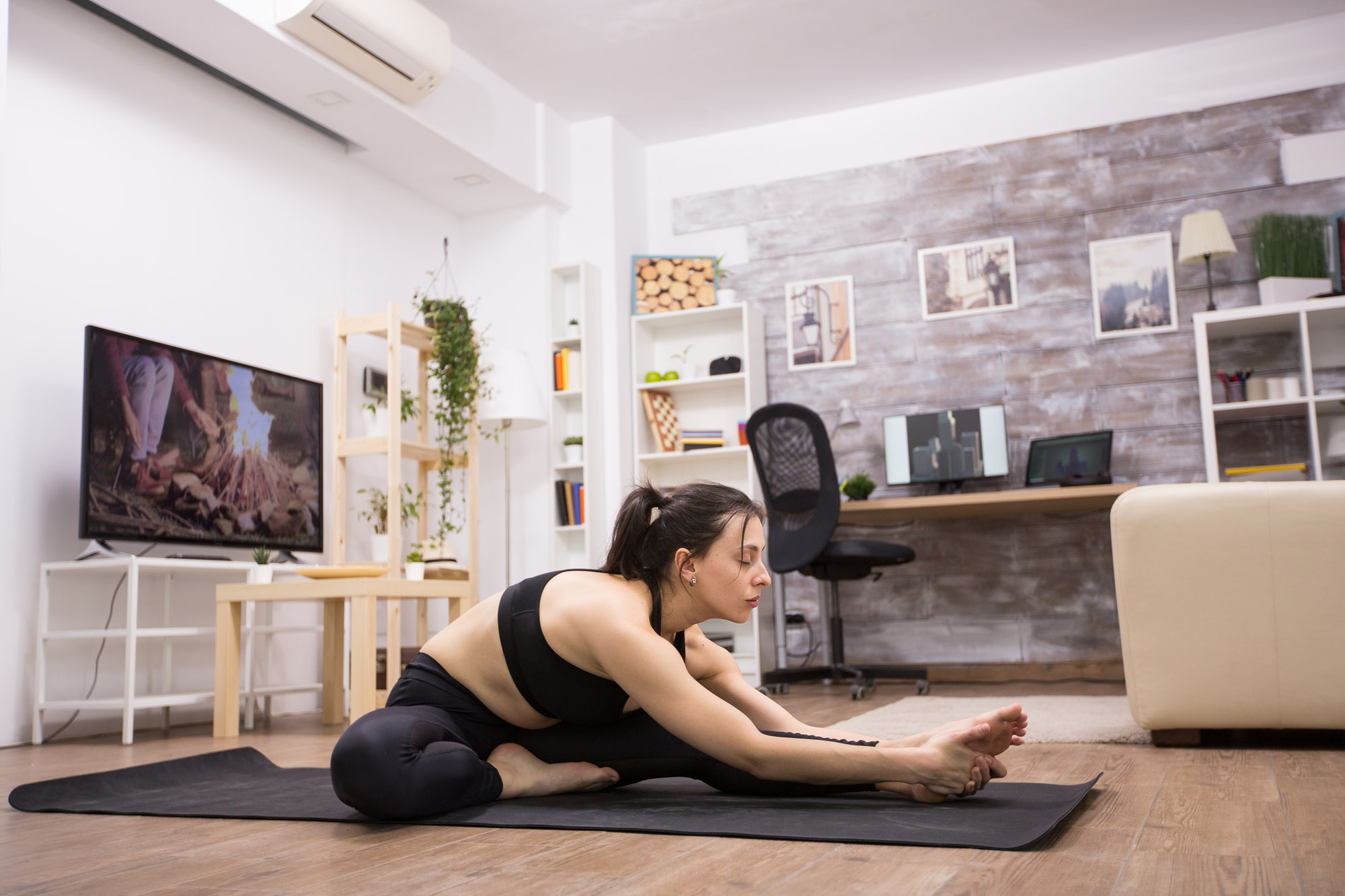 Female yoga practitioner doing her exercise at home